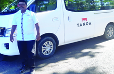photo of tanoa skylodge staff member standing in front of a tanoa branded van