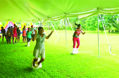 photo of 2 children in a sack race at the tanoa tusitala hotels kids fun day