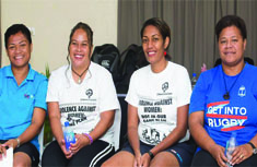 4 women from the Ocean Rugby training team sitting on a chair at Tanoa Skylodge Hotel