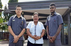 2 male and 1 female Tanoa Waterfront Hotel staff members standing on a deck