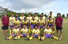 the Sogi FC Football team posing for team photo in yellow shirts